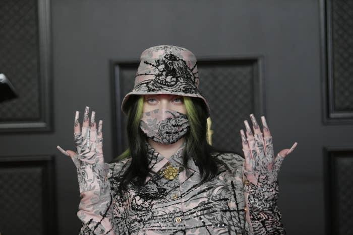 Billie Eilish is photographed at the Grammy Awards showing off her elaborate nails