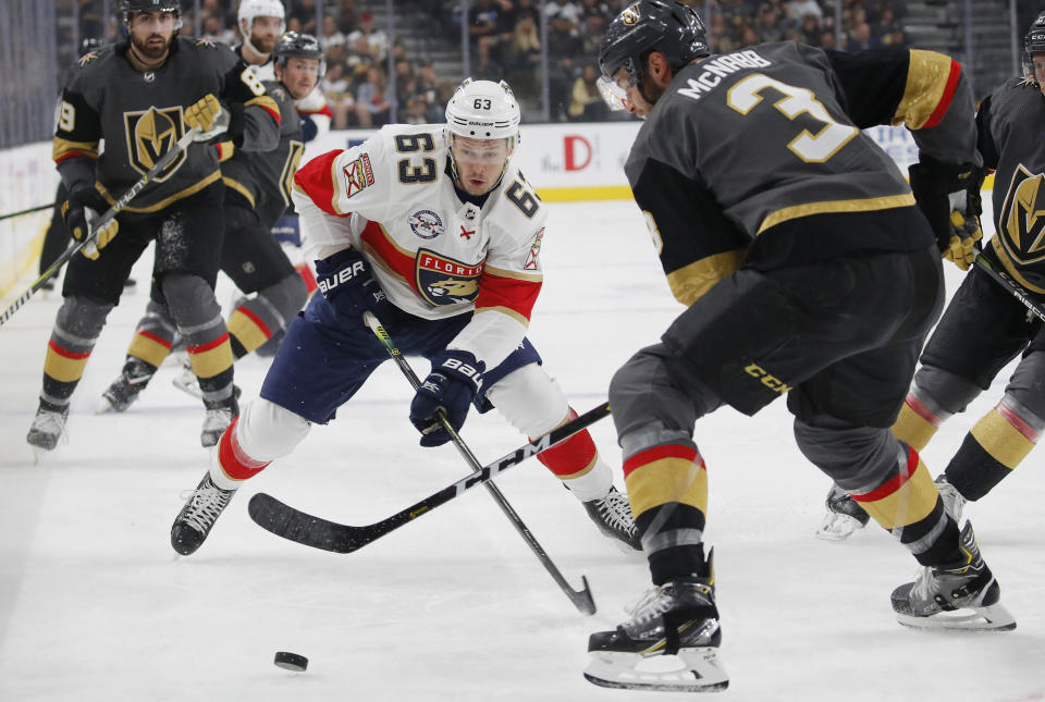 Florida Panthers right wing Evgenii Dadonov (63) competes for the puck with Vegas Golden Knights defenseman Brayden McNabb (3) during the first period of an NHL hockey game Thursday, Feb. 28, 2019, in Las Vegas. (AP Photo/John Locher)