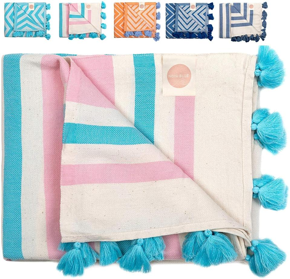 <p>Made from 100 percent Turkish cotton, the <span>Nova Blue Turkish Beach Towel</span> ($23) is so soft, light, and cute with tassel detailing. </p>