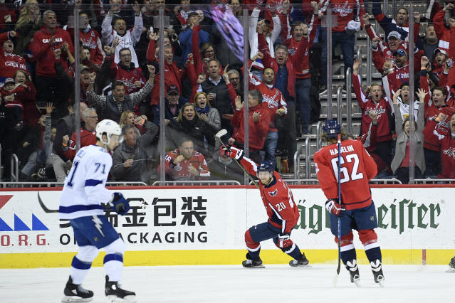 Washington Capitals center Lars Eller (20), of Denmark, celebrates his goal with left wing Carl Hagelin (62) as Tampa Bay Lightning center Anthony Cirelli (71) skates by during the first period of an NHL hockey game Wednesday, March 20, 2019, in Washington. (AP Photo/Nick Wass)