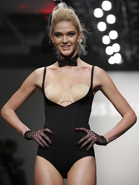 CAPTION CORRECTION, CORRECTS TO REMOVE REFERENCE TO ANNA SUI, WHOSE COLLECTION WAS NOT REPRESENTED AT THIS SHOW - A model pauses at the end of the runway during the presentation of the GS Shop Lingerie show featuring Spanx, Wonderbra, and Platex during Fashion Week Tuesday, Feb. 4, 2014, in New York. (AP Photo/Kathy Willens)