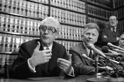 """Former FBI officials, Mark Felt, left, and Edward S. Miller, appear at a news conference, in this April 15, 1981 file photo after learning that President Reagan had pardoned them from their conviction of unauthorized break-ins during the Nixon administration's search for opponents during the Vietnam War. Felt, the former FBI second-in-command who revealed himself as """"Deep Throat"""" 30 years after he tipped off reporters to the Watergate scandal that toppled a president, died Thursday Dec. 18, 2008. He was 95. (AP Photo/Bob Daugherty)"""