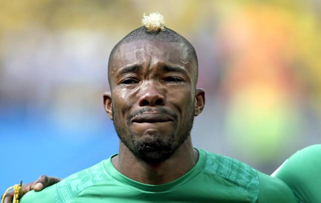 Ivory Coast's Serey Die is overcome with emotion as they play the national anthem before the group C World Cup soccer match between Colombia and Ivory Coast at the Estadio Nacional in Brasilia, Brazil, Thursday, June 19, 2014. (AP Photo/Marcio Jose Sanchez)