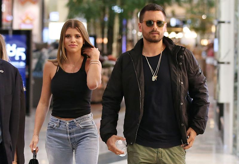 Sofia Richie (Left) and Scott Disick (Right) walk side by side