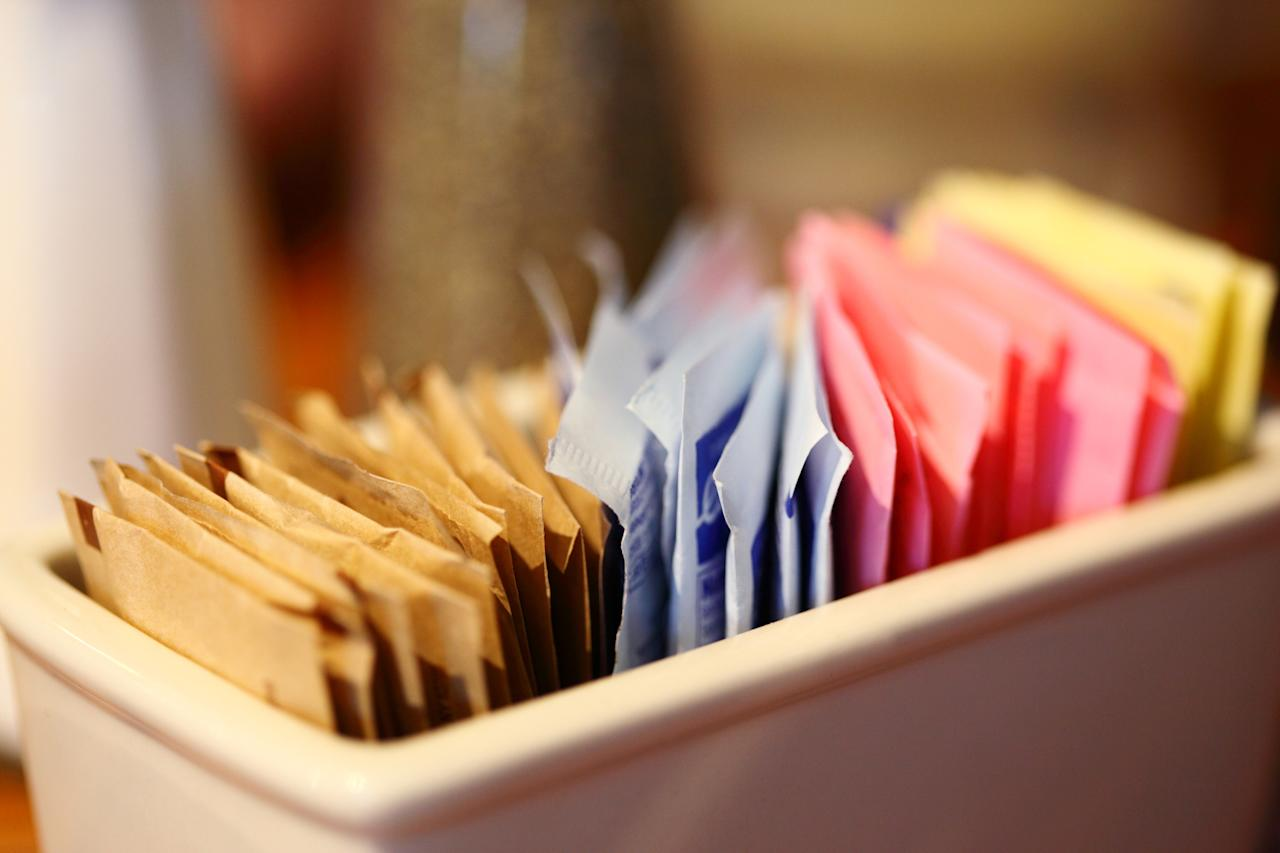 <p>Last year, a Canadian study directly linked artificial sweeteners with long-term weight gain. Obesity, diabetes, high blood pressure and heart disease are also common side effects of the over consumption of artificial sweeteners. One of the most common artificial sweeteners is aspartame which is believed to block the enzyme that prevents obesity while increasing appetite. </p>