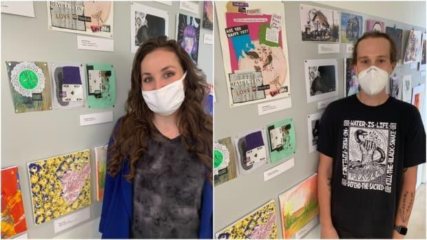 Meaghan Sweeney (left) and Janet MacIsaac (right) stand next to their pieces of art featured in the Pride & Joy Community Art Exhibition at the Art Gallery of Windsor. (Katerina Georgieva/CBC - image credit)