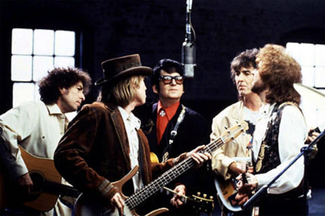 <p>From left: Bob Dylan, Tom Petty, Roy Orbison, George Harrison, and Jeff Lynne perform as the groundbreaking supergroup Traveling Wilburys in 1988. (Photo: @OfficialWilburyVEVO via YouTube) </p>