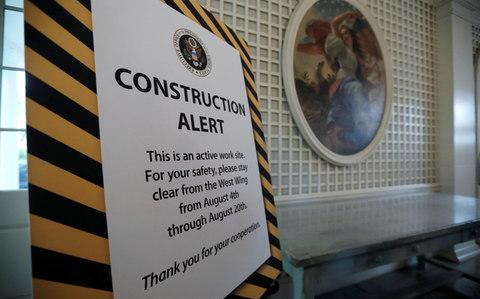 A sign in the Palm Room warns of the closure of the West Wing of the White House due to construction during renovations in Washington - Credit: Reuters