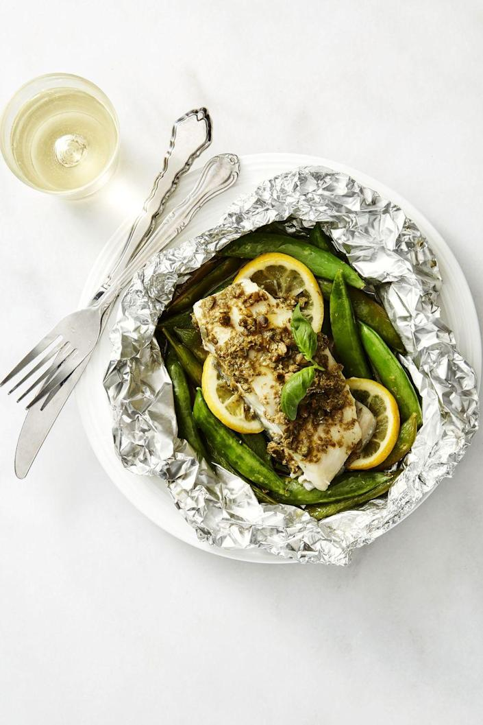 """<p>We <em>love</em> a simple """"assembly"""" dinner: This fish plate comes together by simply throwing in a handful of ingredients into a packet and then into the oven. Done!</p><p><em><a href=""""https://www.goodhousekeeping.com/food-recipes/a39351/fish-packets-with-caper-butter-and-snap-peas-recipe/"""" rel=""""nofollow noopener"""" target=""""_blank"""" data-ylk=""""slk:Get the recipe for Fish Packets with Caper Butter and Snap Peas »"""" class=""""link rapid-noclick-resp"""">Get the recipe for Fish Packets with Caper Butter and Snap Peas »</a></em></p>"""