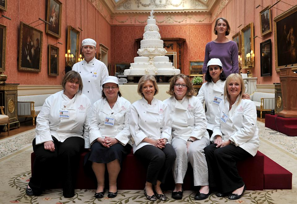 Fiona Cairns and her team pose for a photograph with the Royal Wedding cake that was made for Prince William and Kate Middleton   (Photo by John Stillwell/PA Images via Getty Images)