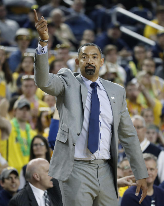 Michigan coach Juwan Howard signals during the second half of the team's NCAA college basketball game against Indiana, Sunday, Feb. 16, 2020, in Ann Arbor, Mich. (AP Photo/Carlos Osorio)