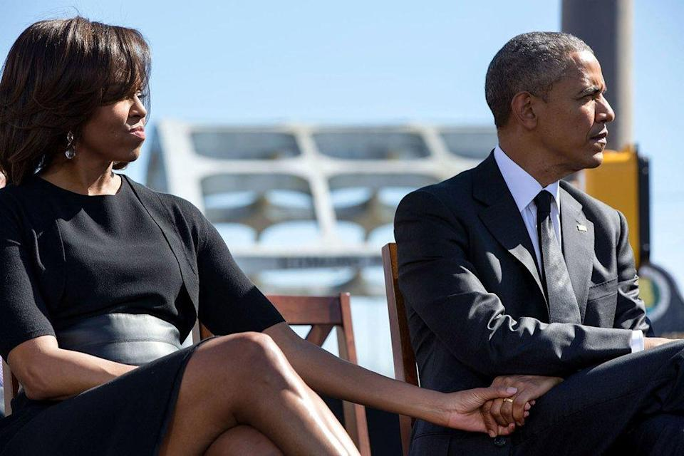 <p>When they quietly held hands as they listen to the remarks of Rep. John Lewis commemorating the 50th Anniversary of Bloody Sunday and the Selma to Montgomery civil rights marches. [Photo: The White House/Pete Souza]</p>