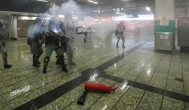 Riot police fire tear gas in Kwai Fong MTR station. Photo: Felix Wong