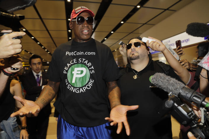 Former NBA basketball player Dennis Rodman, and Chris Volo, right, arrive at Singapore's Changi Airport on Tuesday, June 12, 2018. (AP Photo/Wong Maye-E)