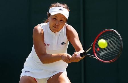 FILE PHOTO: Tennis - Wimbledon - All England Lawn Tennis Club, London, Britain - July 3, 2018. Shuai Peng of China in action during her first round match against Samantha Stosur of Australia. REUTERS/Andrew Couldridge/File Photo