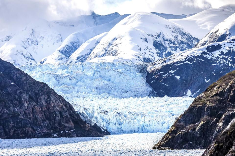 """PIC BY Larry Pannell / CATERS NEWS - (PICTURED The Sawyer Glacier pictured on May 15th 2012 ) These shocking images reveal the ugly truth of climate change, where glaciers in Alaska have melted within five years. Larry Pannell, 56, a photojournalist has been travelling around the world the globe for nine years-  he started spending his summers on cruise ships to Alaska, to see the glaciers. During his last trip he compared images of the 'Inside Passage'  he took in the past and was shocked to realise the massive difference in the amount of ice. Larry said: """"Although I have witnessed the retreat of many glaciers it is hard to notice the difference when you visit year after year. SEE CATERS COPY"""