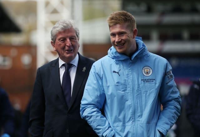 Crystal Palace manager Roy Hodgson shares a joke with Kevin De Bruyne