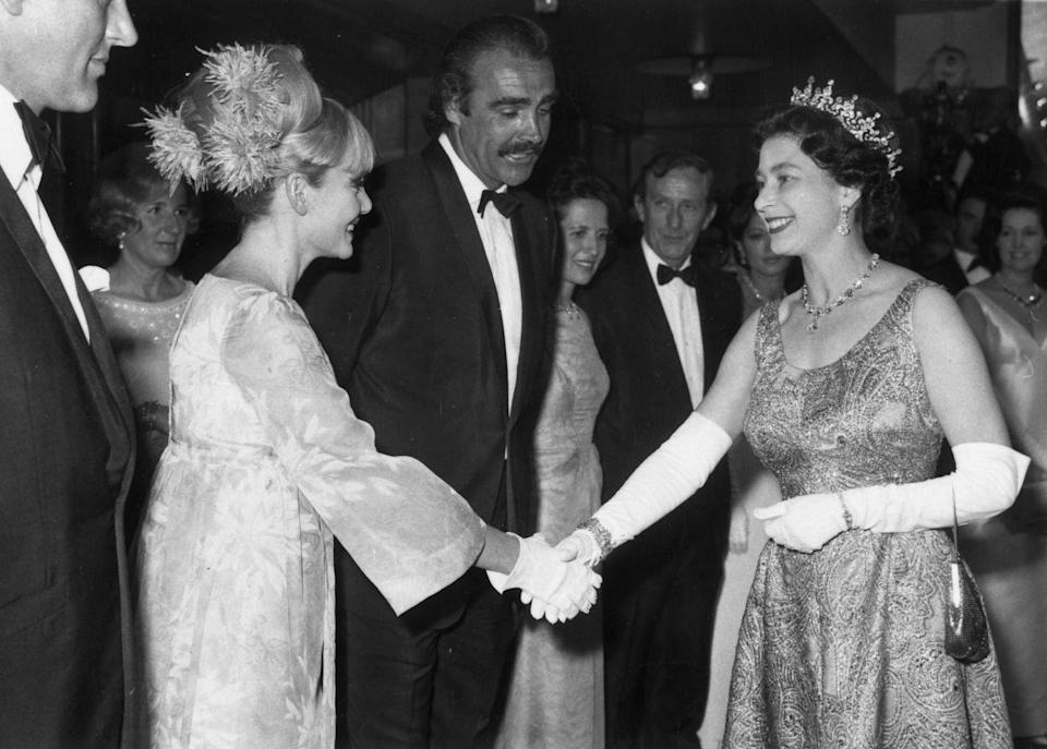 <p>Queen Elizabeth shook hands with Sean Connery and his wife, Diane Cilento, at the <em>You Only Live Twice</em> premiere. </p>