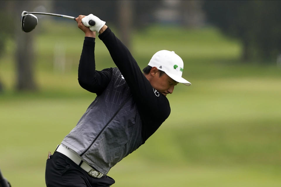 Li Haotong of China, hits his tee shot on the second hole during the third round of the PGA Championship golf tournament at TPC Harding Park Saturday, Aug. 8, 2020, in San Francisco. (AP Photo/Charlie Riedel)