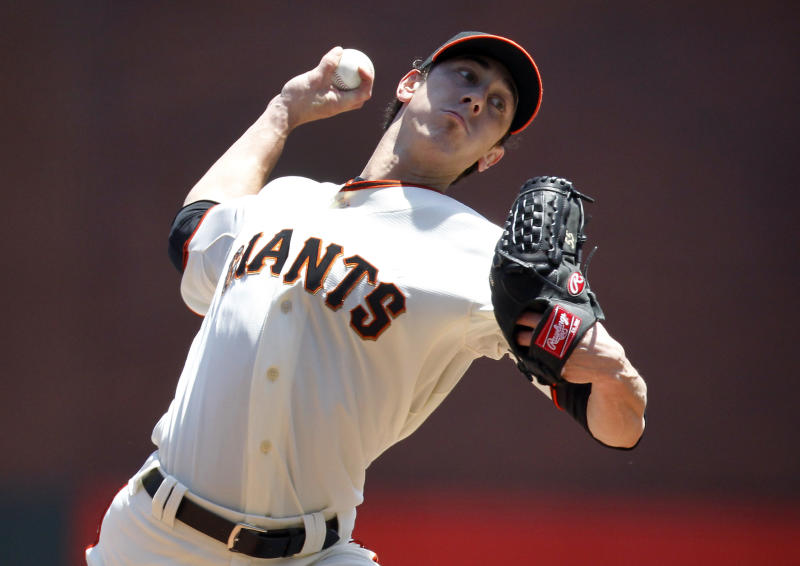 San Francisco Giants starting pitcher Tim Lincecum (55) throws to the Atlanta Braves during the first inning of a baseball game in San Francisco, Sunday, May 12, 2013. (AP Photo/Tony Avelar)