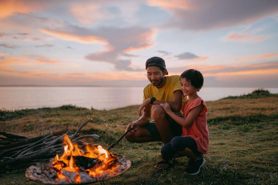 """<p>End his Father's Day on a sweet note by roasting marshmallows over the fire. As people are eating their s'mores, ask everyone in the circle to share their fondest memory with dad or grandpa. It'll make this moment even sweeter. </p><p><a class=""""link rapid-noclick-resp"""" href=""""https://www.goodhousekeeping.com/food-recipes/g27557134/best-campfire-recipes/"""" rel=""""nofollow noopener"""" target=""""_blank"""" data-ylk=""""slk:MAKE THESE CAMPFIRE RECIPES"""">MAKE THESE CAMPFIRE RECIPES</a></p>"""