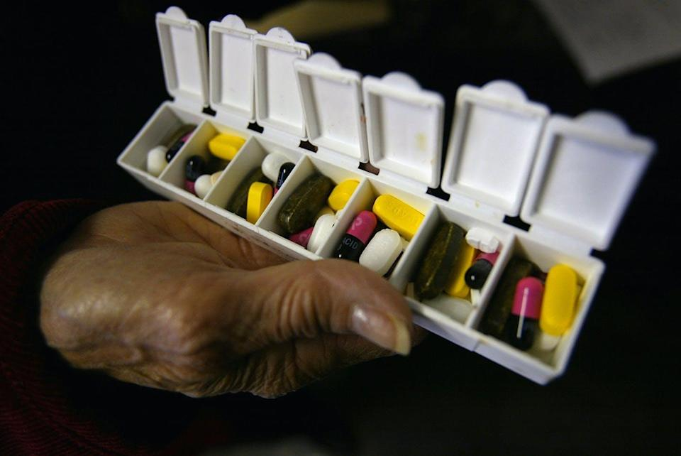 A daily pill container with several types of pills.
