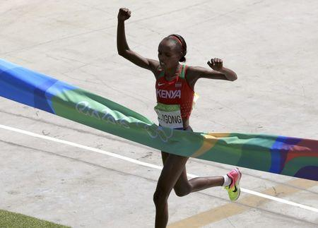 2016 Rio Olympics - Athletics - Final - Women's Marathon -Sambodromo - Rio de Janeiro, Brazil - 14/08/2016. Jemima Sumgong (KEN) of Kenya crosses the finish line to win the race        REUTERS/Dominic Ebenbichler