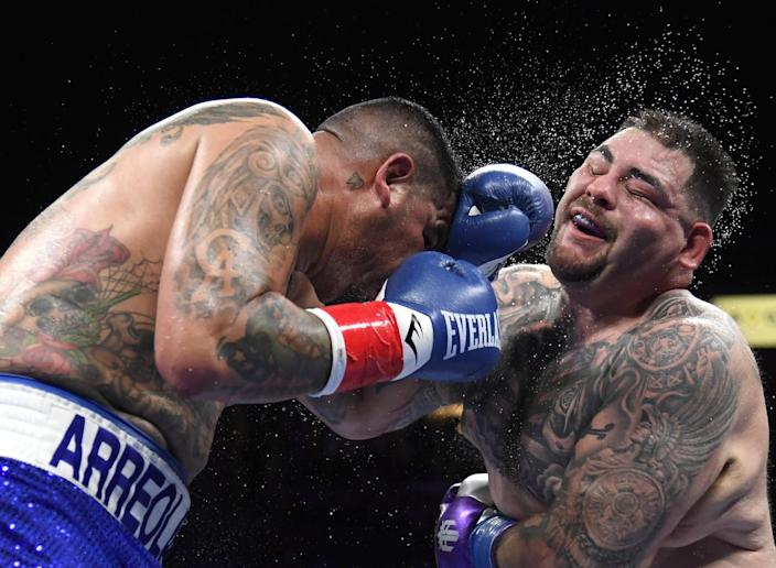 Andy Ruiz Jr. takes a punch from Chris Arreola during their heavyweight fight on Saturday.