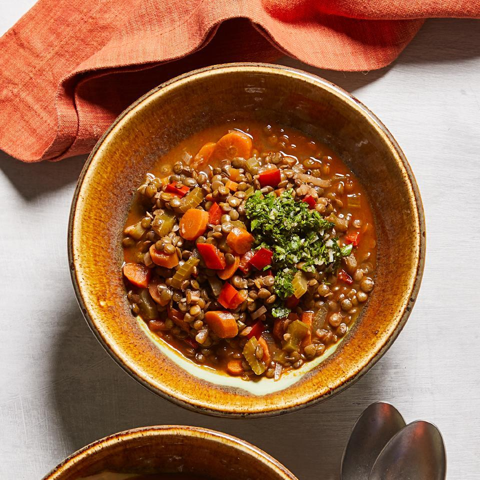 <p>This healthy vegetarian recipe is hearty and satisfying. Don't skip the parsley relish (salsa verde)--it's easy to make and lends a tangy accent that balances the flavors of the lentil stew. We prefer French green lentils for this stew, as they don't fall apart while cooking; however, regular brown lentils (found in most supermarkets) will also work.</p>