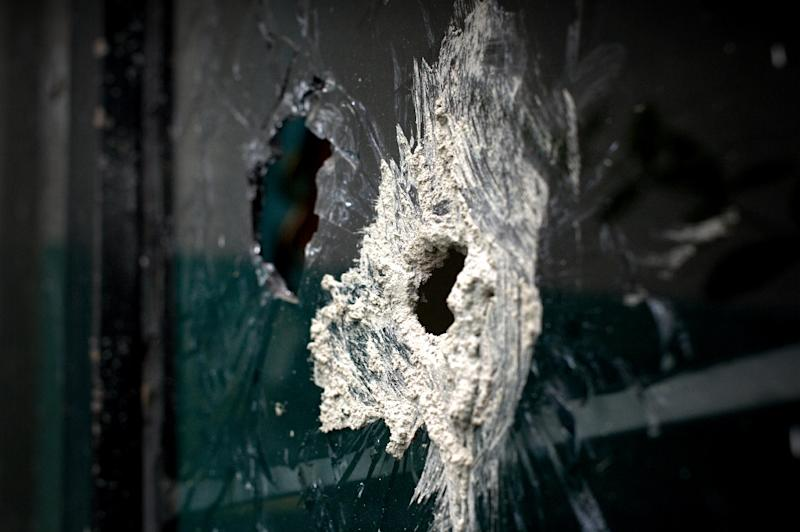Bullet holes in the window of a house neighbouring the one where gunmen attacked the police in Ocotlan, Jalisco state (AFP Photo/Hector Guerrero)