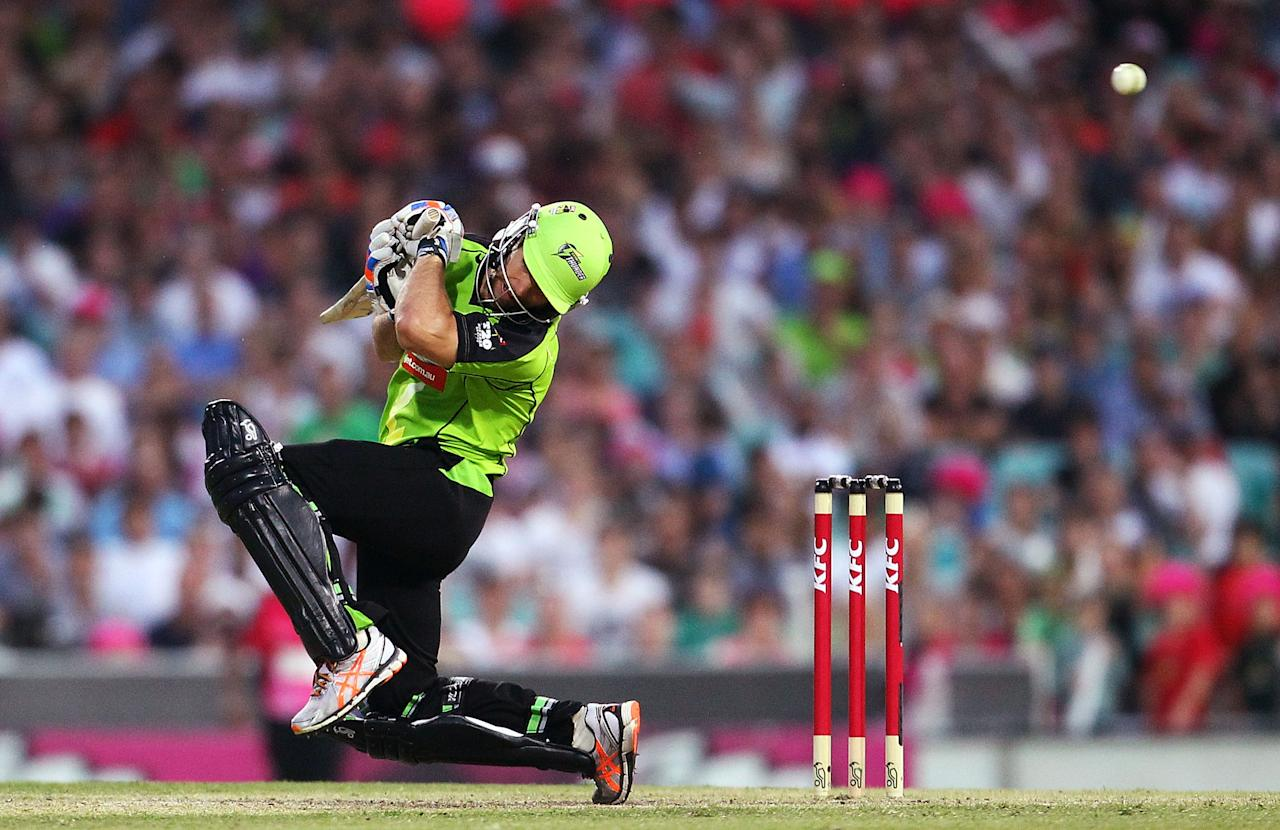 SYDNEY, AUSTRALIA - DECEMBER 08: Cameron Borgas of the Thunder ducks a bouncer by Mitchell Starc of the Sixers during the Big Bash League match between the Sydney Sixers and the Sydney Thunder at Sydney Cricket Ground on December 8, 2012 in Sydney, Australia.  (Photo by Mark Nolan/Getty Images)