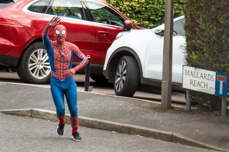 Jason Baird, 34, has been delighting his local community with his superhero alter-ego (PA)