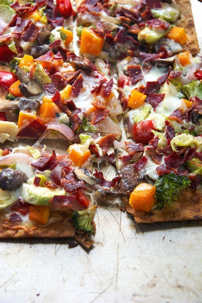 """<p>Roast your veggies in maple syrup for a fall flavored flatbread.</p><p>Get the recipe at <a href=""""http://withsaltandwit.com/maple-roasted-vegetable-crispy-bacon-flatbread/"""" rel=""""nofollow noopener"""" target=""""_blank"""" data-ylk=""""slk:With Salt and Wit"""" class=""""link rapid-noclick-resp"""">With Salt and Wit</a>.</p>"""