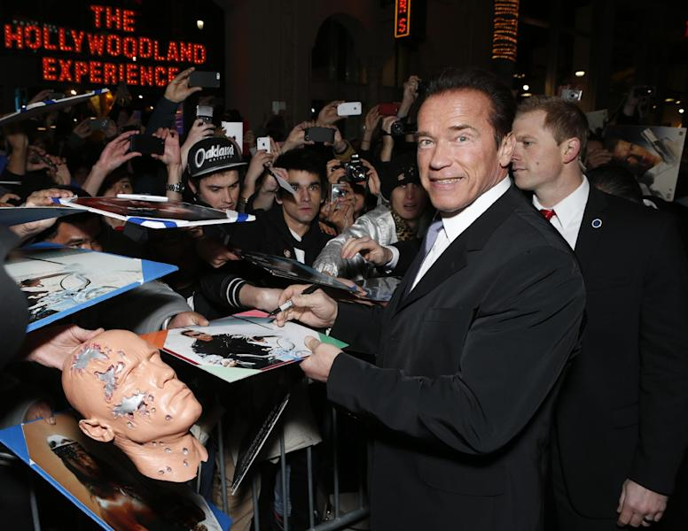 """FILE - In this Jan. 14, 2013 file photo, Arnold Schwarzenegger attends the LA premiere of """"The Last Stand"""" at Grauman's Chinese Theatre, in Los Angeles. (Photo by Todd Williamson/Invision/AP, File)"""
