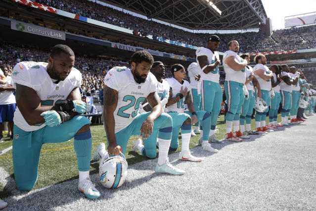 "The Miami Dolphins' new anthem policy reads: ""Players who are on the field during the Anthem performance must stand and show respect for the flag and the Anthem."" (AP)"