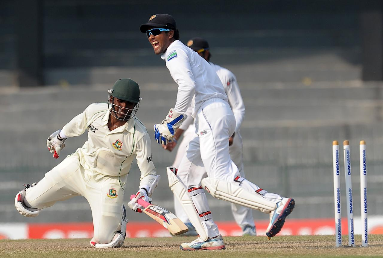Sri Lankan wicketkeeper Dinesh Chandimal (R) stumps out Bangladeshi cricketer Jahurul Islam (L) during the third day of the second Test match between Sri Lanka and Bangladesh at the R. Premadasa Cricket Stadium in Colombo on March 18, 2013. AFP PHOTO/ LAKRUWAN WANNIARACHCHI