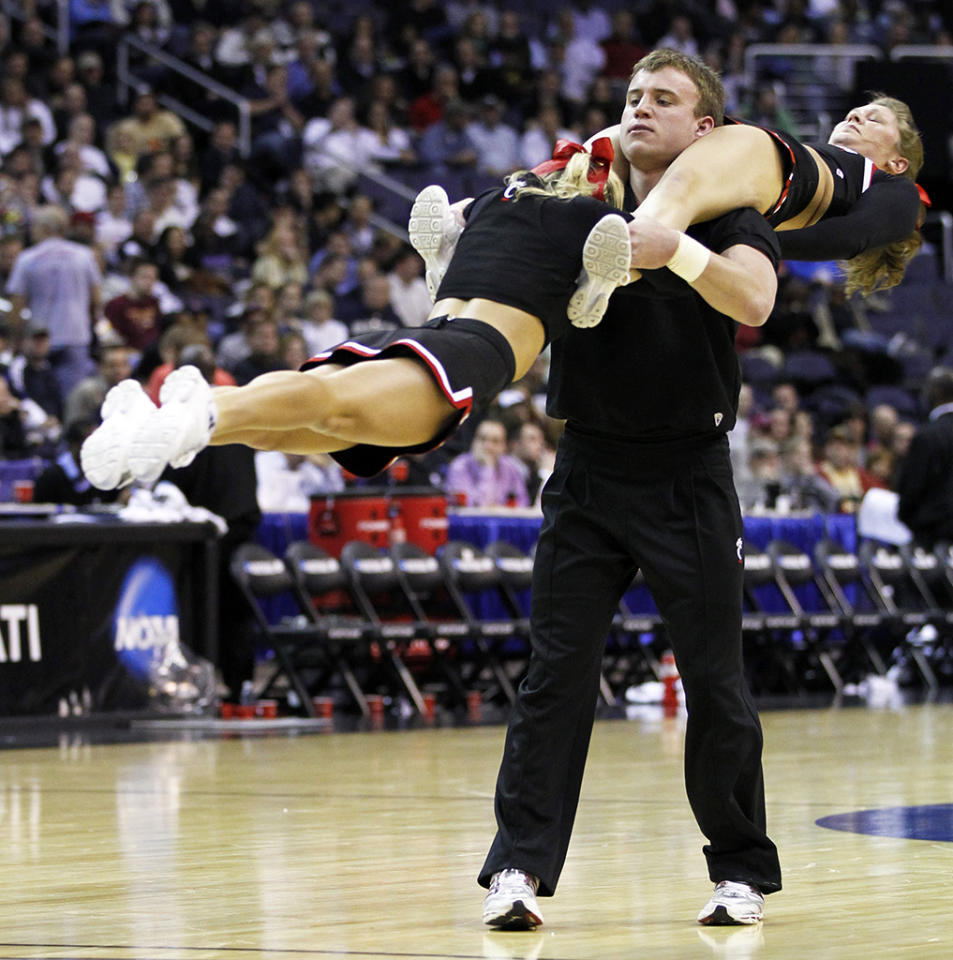 Cincinnati cheerleaders perform during the first half against Connecticut in the third round of the 2011 NCAA Men's Basketball Championship tournament at the Verizon Center in Washington, D.C., Saturday, March 19, 2011. (Harry E. Walker/MCT via Getty Images)