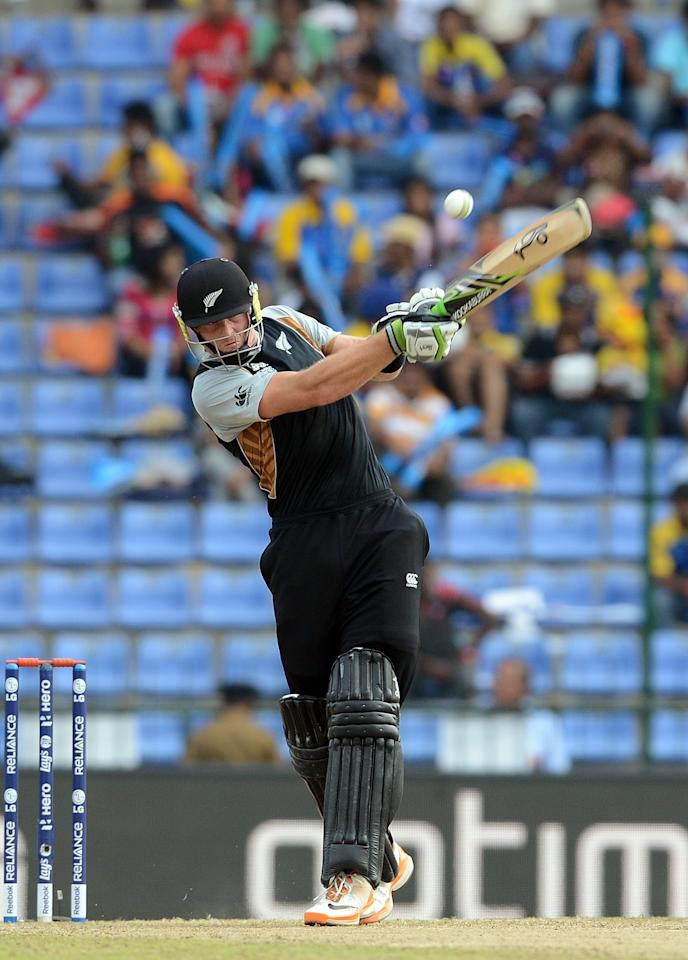New Zealand cricketer Martin Guptill hits a boundary during the ICC Twenty20 Cricket World Cup's Super Eight match between Sri Lanka and New Zealand at the Pallekele International Cricket Stadium in Pallekele  on September 27, 2012. AFP PHOTO/ Prakash SINGH