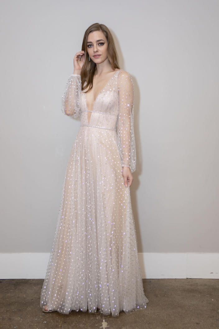 <p>These sheer, embellished sleeves are fit for a modern Disney princess.</p>
