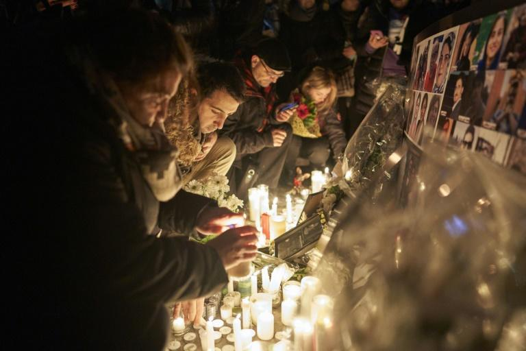 Mourners light candles for the victims of Ukrainian Airlines flight 752 which crashed in Iran during a vigil at Mel Lastman Square in Toronto, Ontario on January 9, 2020