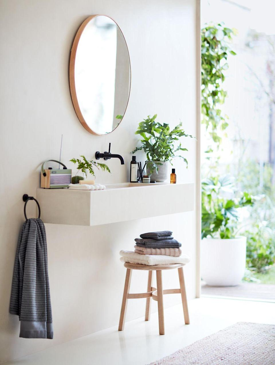 "<p>Inspired by Scandi style, you'll find gorgeous bathroom mirrors, wooden stools, plush towels, air-purifying <a href=""https://www.countryliving.com/uk/homes-interiors/interiors/a32104578/best-indoor-hanging-plants/"" rel=""nofollow noopener"" target=""_blank"" data-ylk=""slk:plants"" class=""link rapid-noclick-resp"">plants</a> and lovely soaps, too. </p><p><a class=""link rapid-noclick-resp"" href=""https://go.redirectingat.com?id=127X1599956&url=https%3A%2F%2Fwww.johnlewis.com%2Fbrowse%2Fhome-garden%2Fnew-in-home%2F_%2FN-7opk&sref=https%3A%2F%2Fwww.countryliving.com%2Fuk%2Fhomes-interiors%2Finteriors%2Fg35316655%2Fjohn-lewis-homeware-spring-summer%2F"" rel=""nofollow noopener"" target=""_blank"" data-ylk=""slk:SHOP NOW"">SHOP NOW</a></p>"