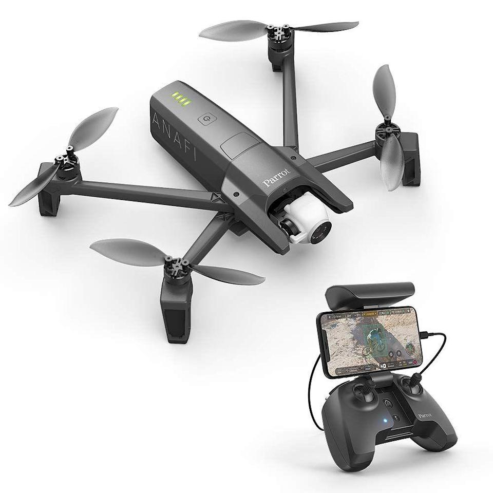 """<p><a class=""""link rapid-noclick-resp"""" href=""""https://www.amazon.co.uk/Parrot-ANAFI-compact-Flying-Camera/dp/B07D5R2JKL/ref=sr_1_1?keywords=Parrot+Anafi&qid=1564095062&s=amazon-devices&sr=8-1&tag=hearstuk-yahoo-21&ascsubtag=%5Bartid%7C1923.g.22798845%5Bsrc%7Cyahoo-uk"""" rel=""""nofollow noopener"""" target=""""_blank"""" data-ylk=""""slk:SHOP"""">SHOP</a></p><p>This 4K HD camera drone can be charged from your laptop or power bank but wins most kudos for its featherweight carbon fibre frame, something that helps it fold down to handheld 'take anywhere' size in a few seconds. You get (almost) half an hour of flight time on one charge, it's great for low-angle shots and it captures video and photos crisply and sharply.</p><p>Amazon.co.uk, £549</p>"""