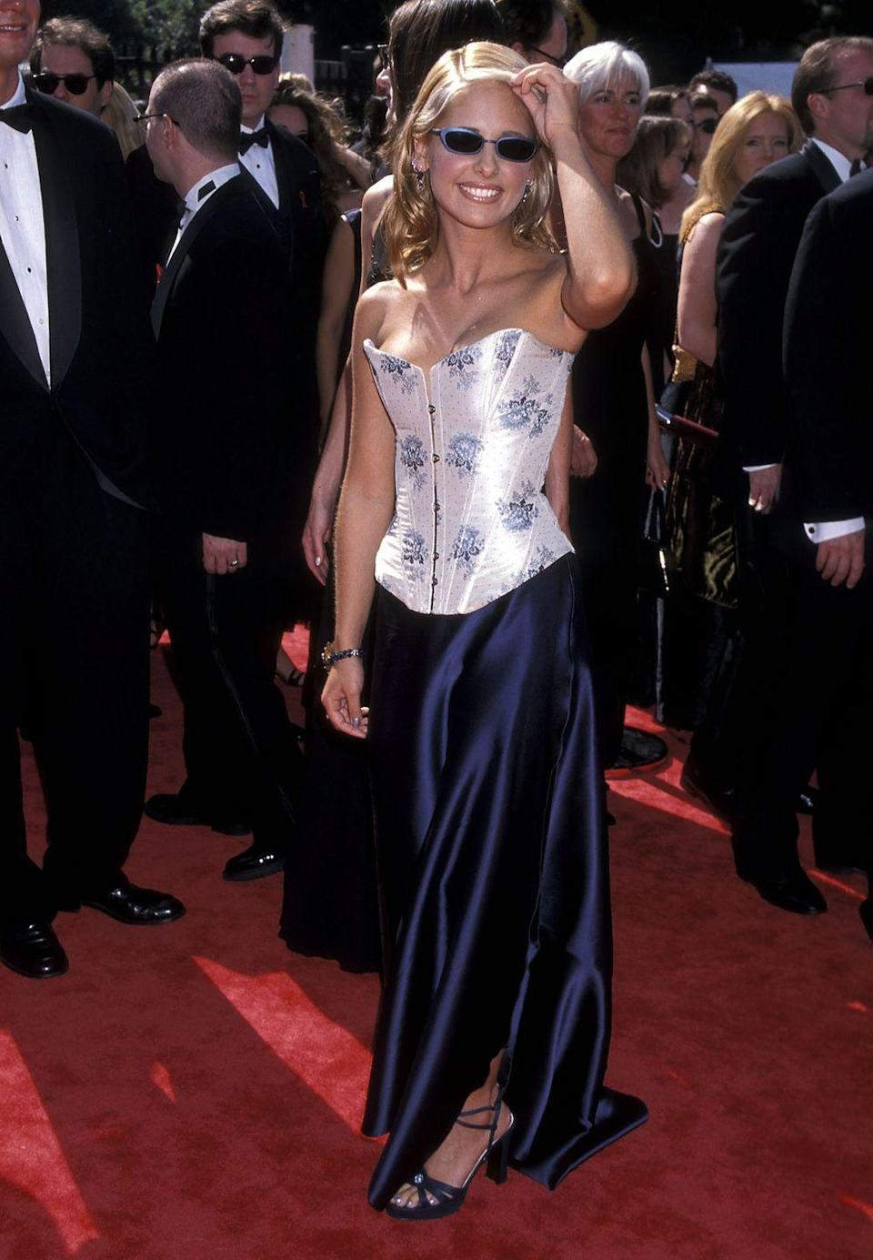 <p>Buffy herself was the epitome of cool at the Emmy Awards in 1998. Also: shades, man.</p>