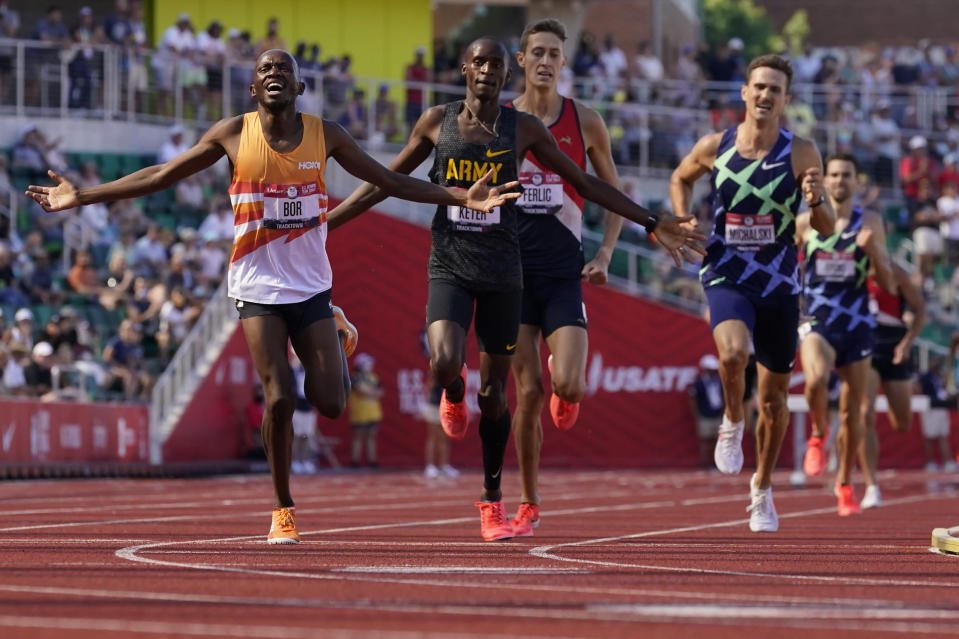 Hillary Bor celebrates after winning in the finals of the men's 3000-meter steeplechase at the U.S. Olympic Track and Field Trials Friday, June 25, 2021, in Eugene, Ore. (AP Photo/Ashley Landis)