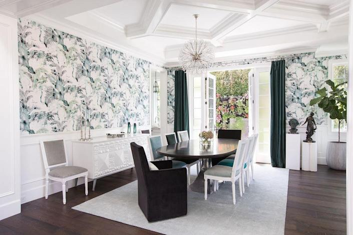 """<p>For this white dining room, <a href=""""https://www.homepolish.com/designers/barbiepalomino"""" rel=""""nofollow noopener"""" target=""""_blank"""" data-ylk=""""slk:Barbie Palomino"""" class=""""link rapid-noclick-resp"""">Barbie Palomino</a> relied on blue and green accent colors to make a statement. <br></p>"""