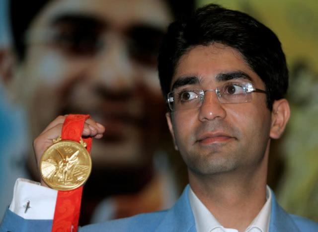 FILE PHOTO: Olympic men's 10m air rifle gold medalist Bindra shows his gold medal during news conference in New Delhi