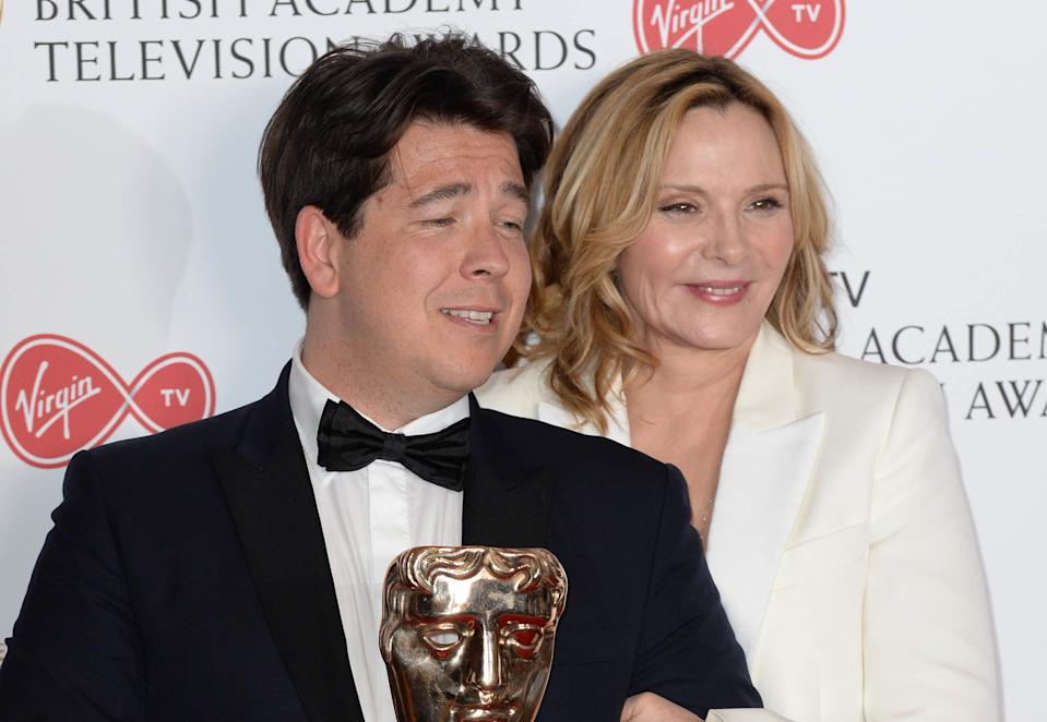 Kim Cattrall presents Michael McIntyre with the award for Best Entertainment Performance in the winners photo area at the Virgin British Academy Television Awards (BAFTA) held at the Royal Festival Hall, Southbank, London. Photo credit should read: Doug Peters/ EMPICS Entertainment