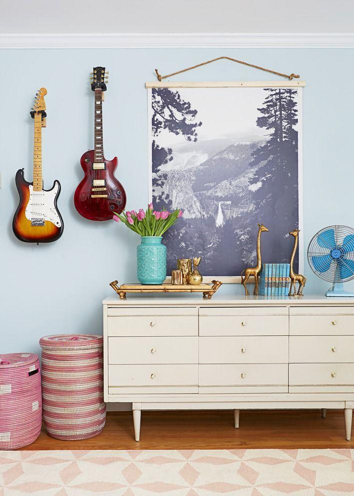 <p>Dress up bare walls with one of the photos on your camera roll. Get a favorite shot digitally enlarged and then add strips of wood along the top and bottom as a quick frame. </p>