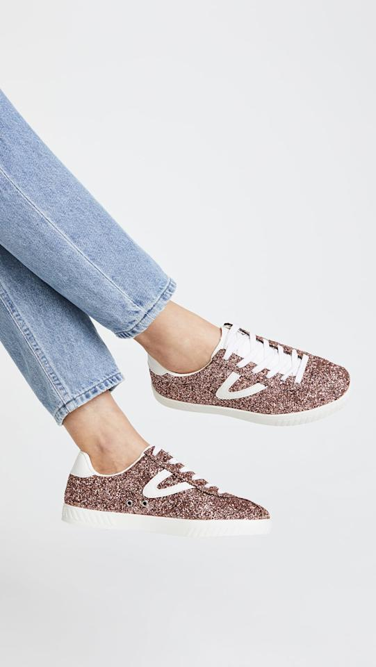 """<p><a href=""""https://www.popsugar.com/buy/Tretorn%20Camden%20Classic%20Sneakers-370282?p_name=Tretorn%20Camden%20Classic%20Sneakers&retailer=amazon.com&price=85&evar1=fab%3Aus&evar9=44311634&evar98=https%3A%2F%2Fwww.popsugar.com%2Ffashion%2Fphoto-gallery%2F44311634%2Fimage%2F44311830%2FTretorn-Camden-Classic-Sneakers&list1=shopping%2Cshoes%2Csneakers%2Choliday%2Cgift%20guide%2Cfashion%20gifts%2Cgifts%20for%20women&prop13=mobile&pdata=1"""" rel=""""nofollow"""" data-shoppable-link=""""1"""" target=""""_blank"""" class=""""ga-track"""" data-ga-category=""""Related"""" data-ga-label=""""https://www.amazon.com/Tretorn-wtCamden5-Womens-Camden5-Sneaker/dp/B071JY6RTJ?th=1"""" data-ga-action=""""In-Line Links"""">Tretorn Camden Classic Sneakers</a> ($85)</p> <p>""""I'm a sucker for sparkly shoes, so these adorable kicks obviously caught my eye. You can't help but smile when you see the rose gold glitter glistening as you walk. I'll wear these with jeans and a tee on the weekends."""" - Macy Cate Williams, editor, Shop and Must Have</p>"""