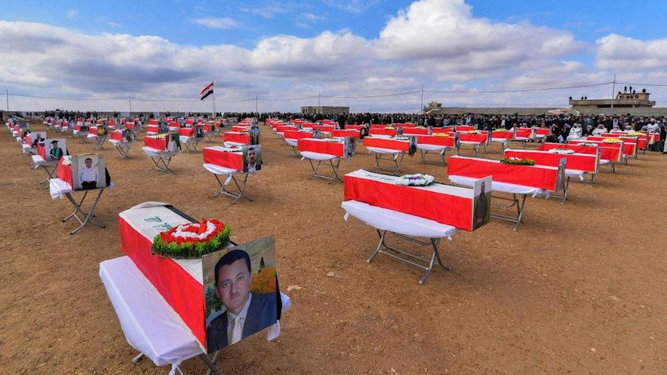 Coffins are spaced out at the mass funeral in Kocho on 6 February 2021